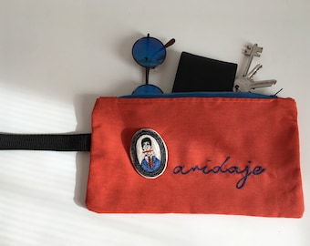 Cotton clutch bag, wristwatch, pouch