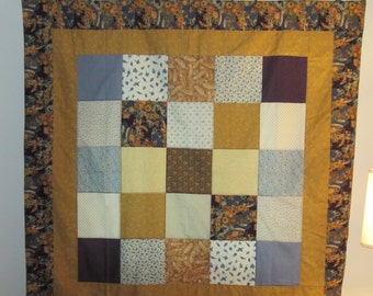 Purple and gold patchwork tablecloth