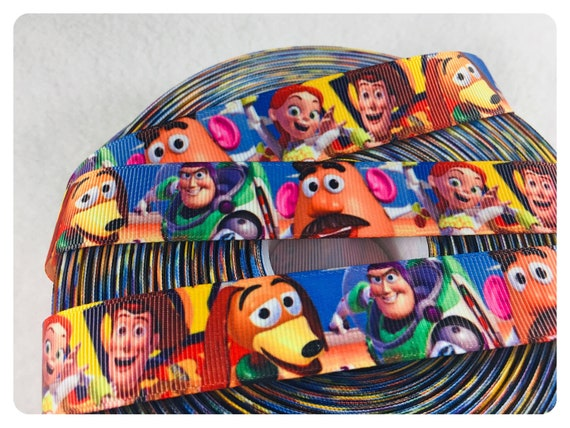 "Toy Story 1/""  grosgrain ribbon the listing is for 3 yards and 2 flat resin"