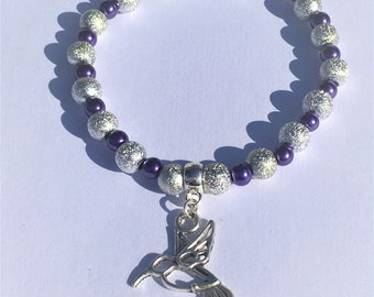 """The purple and silver bird"" bracelet"