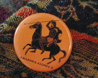 Amazons Allons-Y. Amazons, Let's Go. Original button by Liza Cowan.