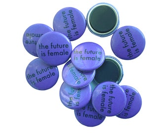 the future is female magnet, remake of the original button which I designed in 1974, purple fridge magnet, feminist household, boss lady