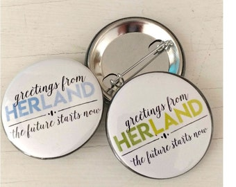 "1.5"" button from our HerLand Collection. The Future Starts Now."