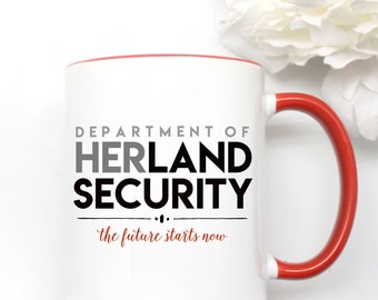 Department of Herland Security. 11 oz mug with red handle