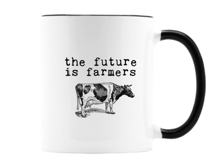 The Future Is Farmers. 11 oz ceramic mug with vintage black and white cow illustration . Black or white handle. Free Shipping.