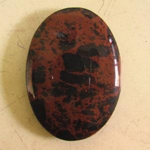 Natural mahogany Obsidian cabochone 43\u00d724mm.33.10cts...1653#