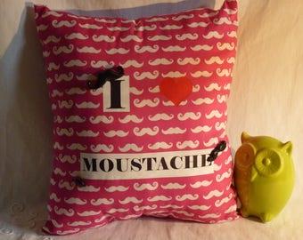 Pink mustache on bottom cushion
