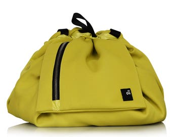 Baby changing backpack for trendy mother, convertible in a shoulder bag, yellow and black, christmas gift idea
