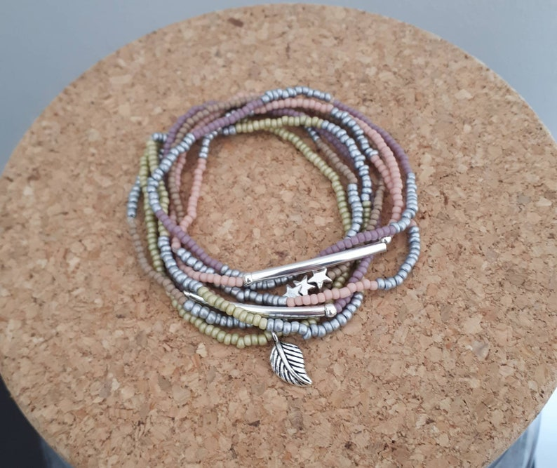 the Keops Set of bracelets made of seed and glass beads of all colors pastel tone with charms