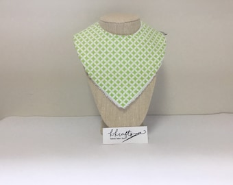 Soft lime green and white patterned bib.