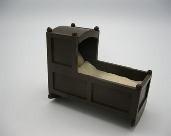 Dolls house 1/12th scale Dark oak style rocking crib or cot with sumptuous bedding
