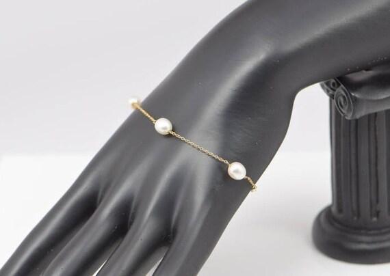 4d8b9a47f67 Tiffany   Co. 18k Yellow Gold Peretti 5 Pearl Bracelet