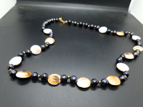 Brown Spiral Shells with Black Fresh-Water Pearls