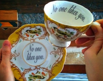 Yellow Insult teacup and saucer, 9 available insults