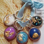 5 Knitting or crochet  stitch markers. Gold flake