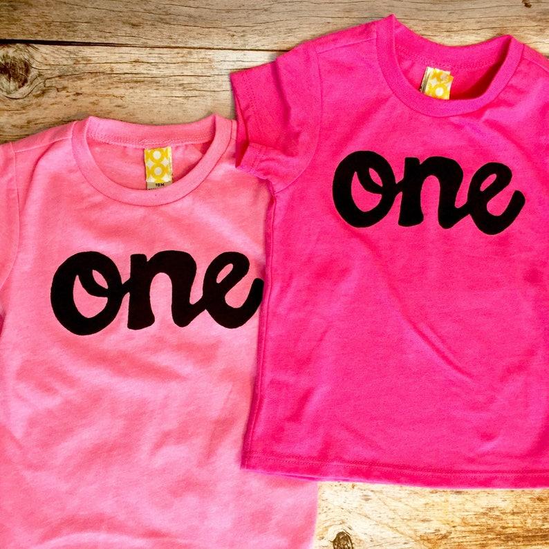 Light Or Dark Pink 1st Birthday Shirt Girl One Script Black