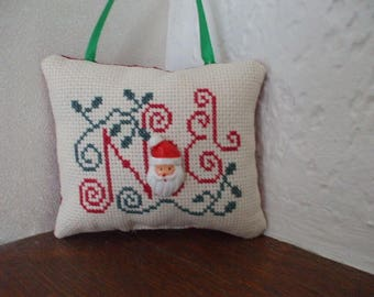 Intricately embroidered cross stitch Santa cushion