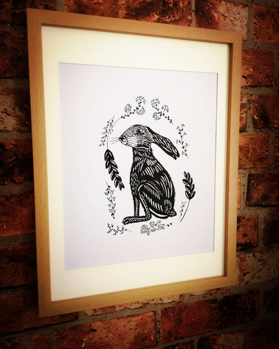 Hand drawn black and white original hare drawing picture in a frame