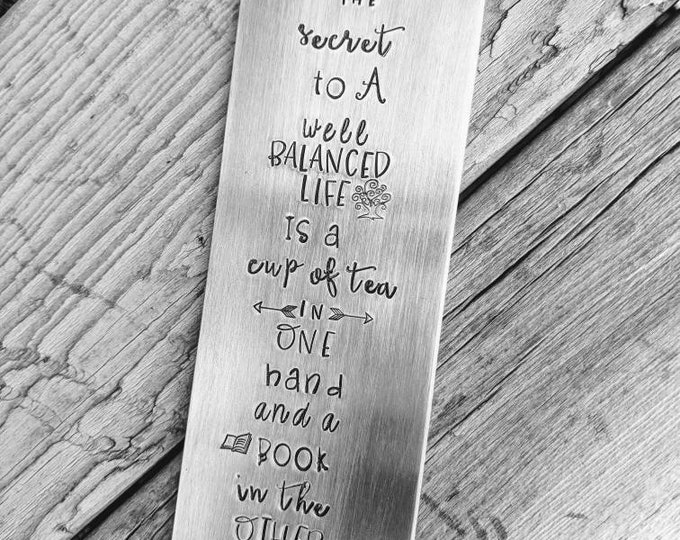 Book lover. Hand stamped aluminum bookmark. book lover. book nerd. book worm. librarian. The secret to a well balanced life. Cup of tea.