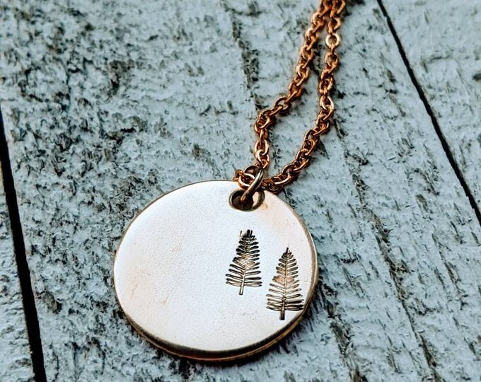 Outdoor scene nugold necklace. Trees. Outdoors. Mountains. Wyoming. Pine tree necklace.