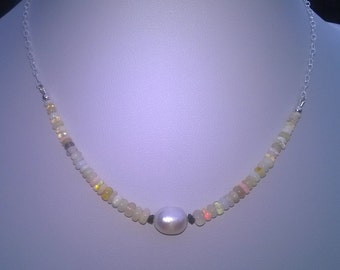 Opal, pearl and diamond necklace.