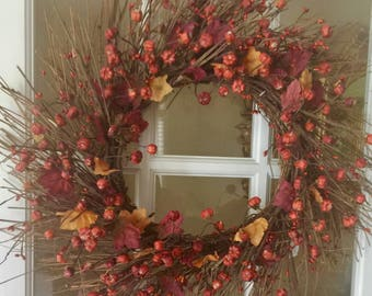 "22"" Pumpkin and Leaves pip Berry wreath."