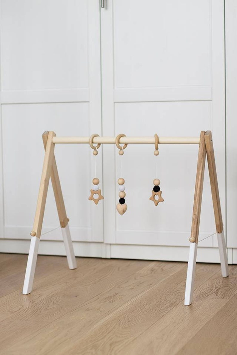 Wooden baby gym with three hangers  hanging toys  Activity image 0