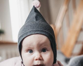 494ae2e2438 Baby hat dark gray with pink pom pom