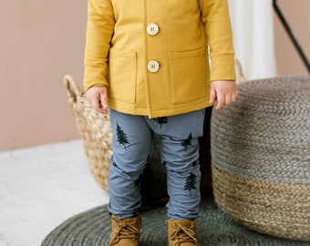 Blue organic cotton boy pants with pockets with spruces pattern