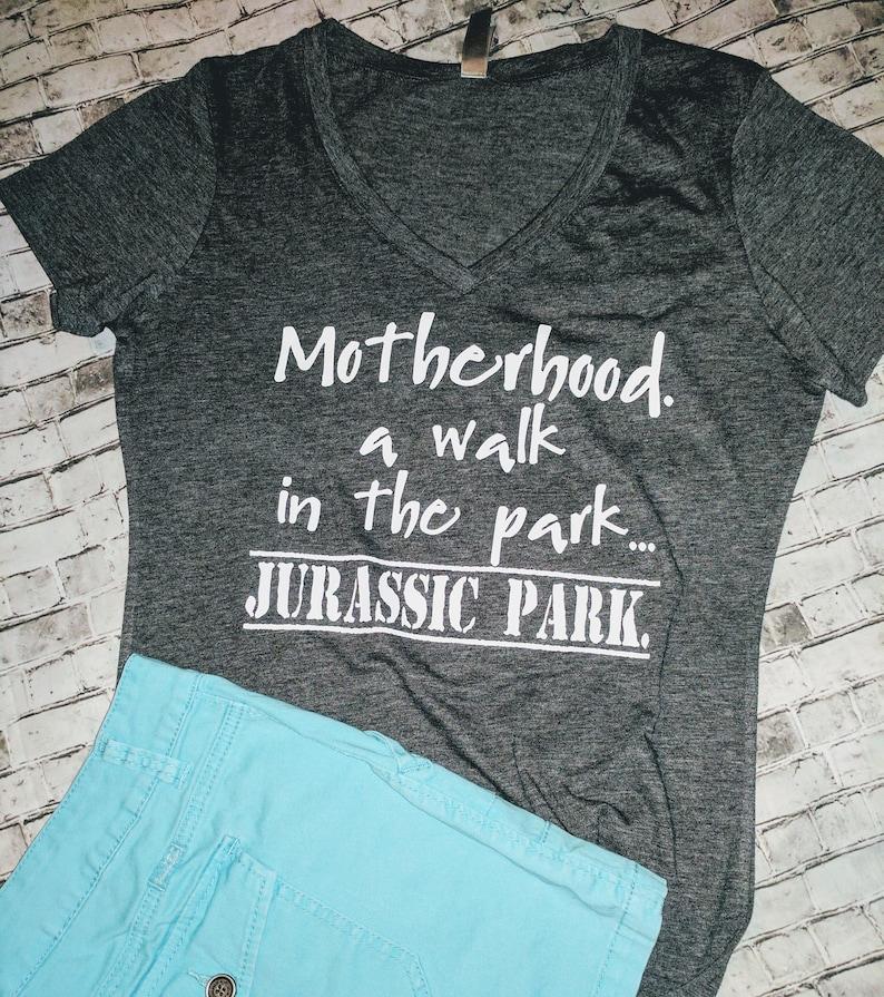 d11df6b32e2 Motherhood. A walk in the park. Jurassic Park. T-shirt