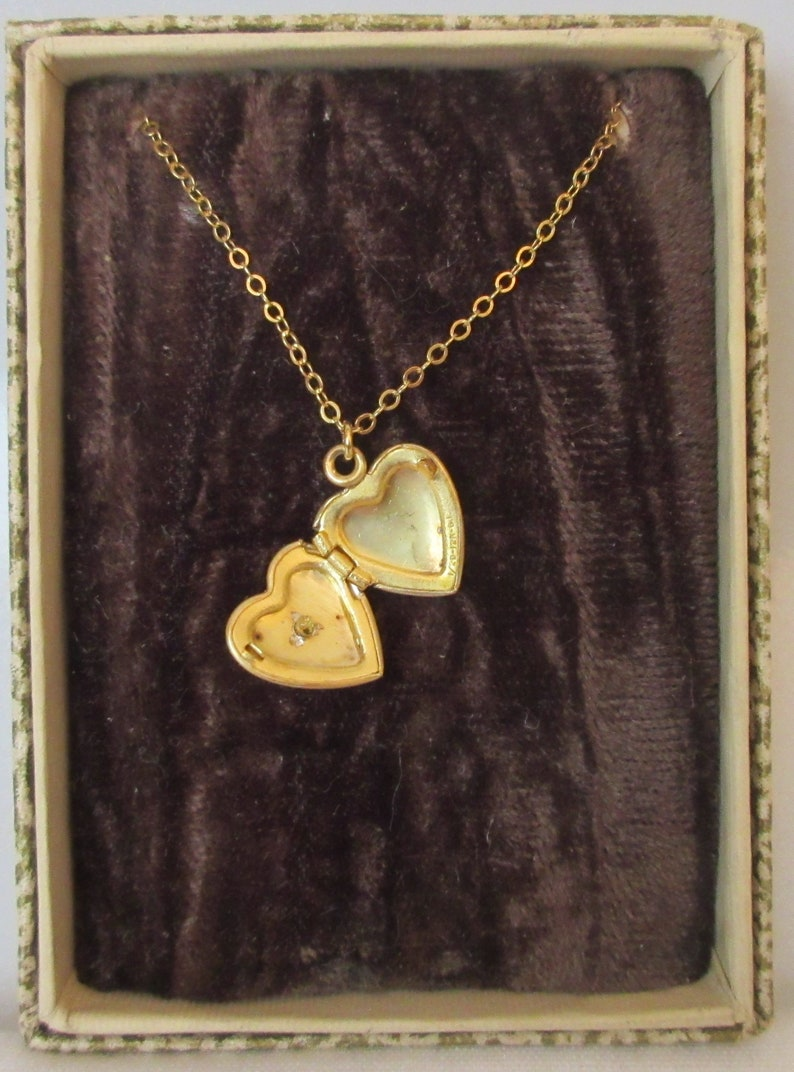Vintage child/'s Heart Locket  with Mother of Pearl and Cross accent marked 120 12K GF
