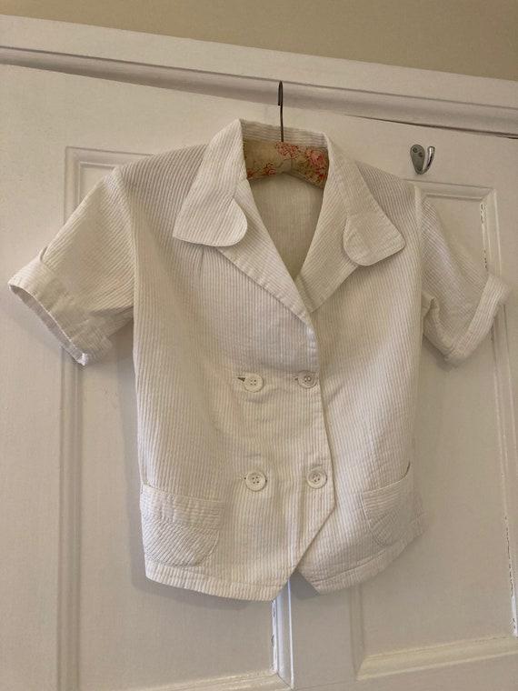 1930s ribbed ivory cotton short sleeve waistcoat s