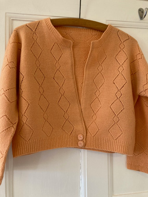 1940s hand knitted, apricot coloured cropped cardi