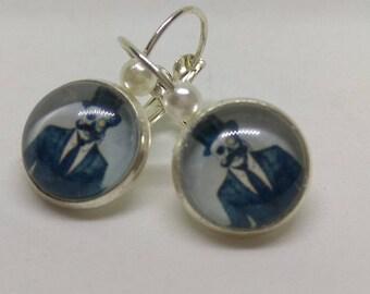 loop 925 Silver earrings, stylized skull cabochon