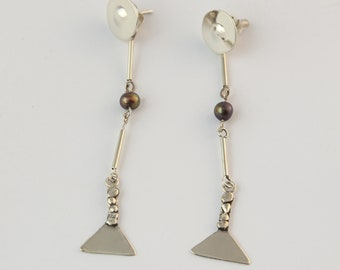 c95898024 Modern Mapuche earrings with cultivated pearls.