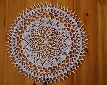 Hand crocheted doily ecru