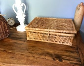Small vintage suitcase in braided wicker