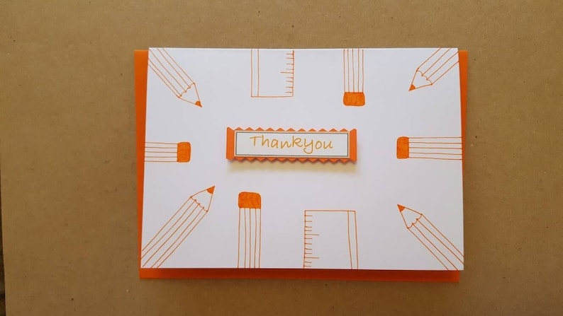 Blank inside Thank you Worldwide shipping available Pencils and rulers Teacher card Orange