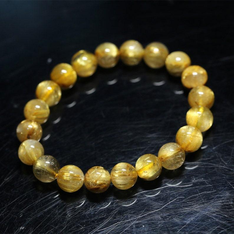High Quality Natural Genuine Arrange Titanium Gold Hair Rutile Quartz Cat/'s Eye Stretch Bracelet Round Beads 9.5mm 04282