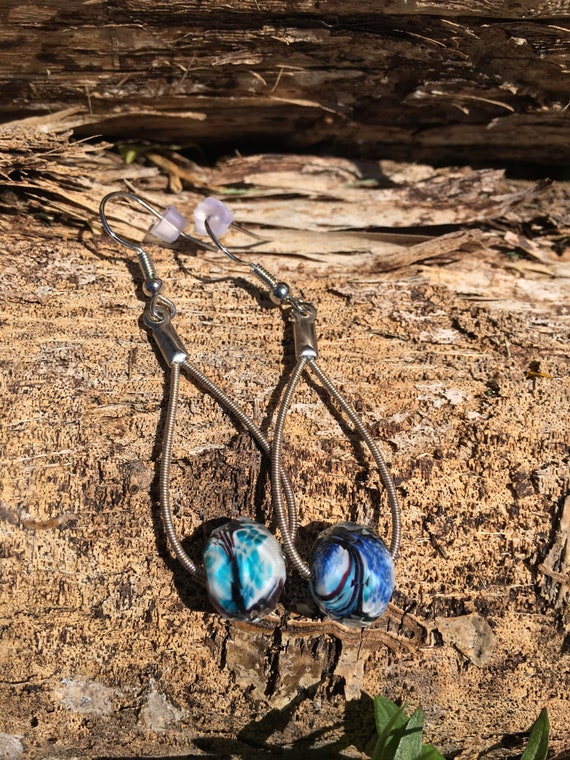 Up-Cycled Steel Guitar String Earrings With Swirled Glass Crystal Embellishment.