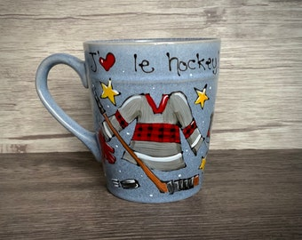big porcelain cup hockey theme, red black, jersey stick skate, blue-gray textured cup