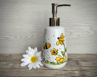 Soap pump with bee, flowers and honey aveoli, with flower