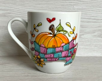 small porcelain coffee cup with pumpkin scarf, sunflower, autumn