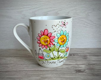 small porcelain coffee cup with characters of flowers friends, smiling, butterflies, flowers, heart, friendship, coral, turquoise