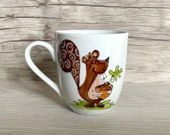 small porcelain coffee cup with squirrel and hazelnut, autumn