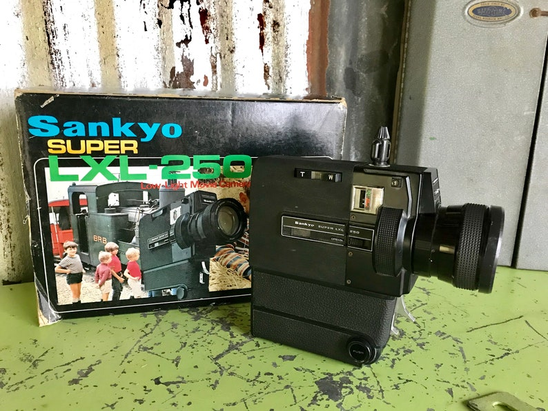 Vintage Sankyo Super LXL-250 Super 8 Cartridge Movie Camera 9-22 5 mm Lens  Pushbutton Automatic Zoom Fold Away Pistol Grip
