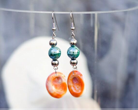Green & seal shell dangle earrings hook - Eye of Saint Lucia
