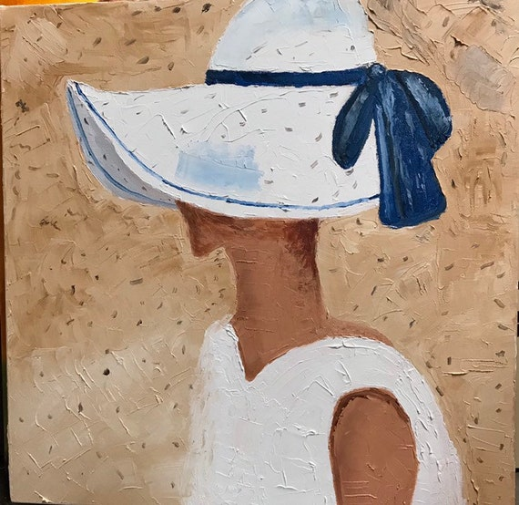 Hat with blue ribbon
