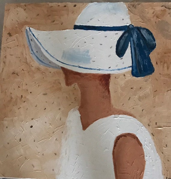White hat with blue ribbon