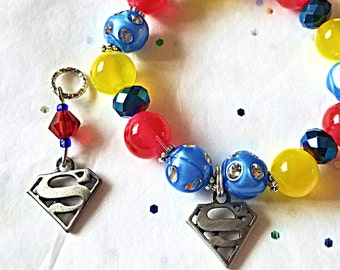 Beaded Charm Bracelet:  Super Hero Girls made with Acrylic Moon Beads!  Matching Hearing Aid Charms Available at a Discounted Bundle Price!